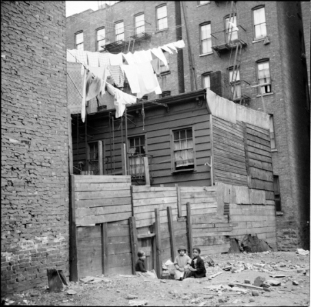 Children play outside a tenement building, 1935. Photo credit: Museum of the City of New York http://blog.mcny.org/2012/08/07/a-fine-line-the-art-of-the-clothesline/